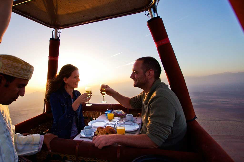 Romantic couple enjoying hot Air balloon ride in dubai