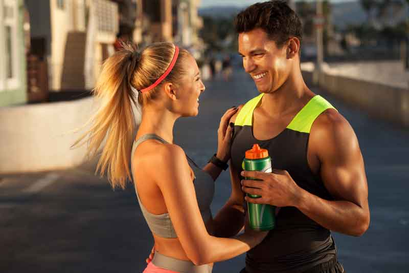 Couple Smiling After Running in an Event In Dubai
