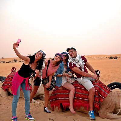 Dress code in Dubai Desert safari images and photos