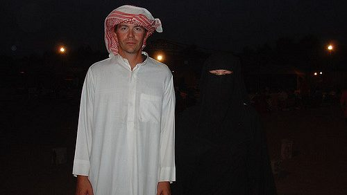Traditional wear of men and women in UAE image